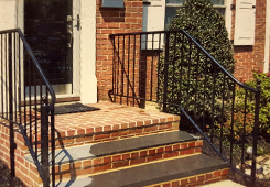 Red Brick Front Steps with Iron Railings