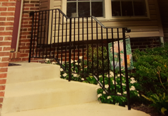 Front Steps with Zig-Zag Designed Iron Railings