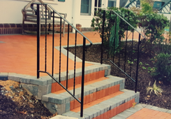 Orange Steps with Iron Railings