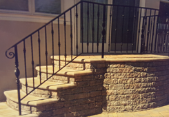 Brick Front Steps with Iron Railings